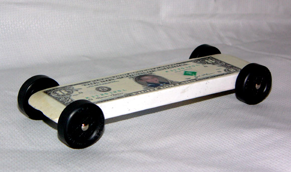 my son had always wanted to build a dollar car so we needed a flat car design to make it look like he wanted we designed the dollar bill which