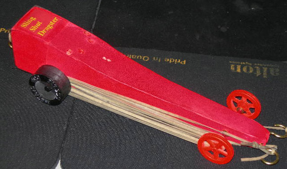 Top fuel cars rocket rubber band and more pinewood derby rubber band car the rubber band is stored around the wheels malvernweather Images